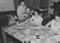 Quilting bee, circa 1940 - 1950.