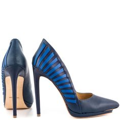 L.A.M.B Nydia Leather point-toe Navy pumps Layers fan through the heel of this fiercely elongated pump. I've worn it one time and could barely walk in them because they are big since I am a size 9 and not 9.5 L.A.M.B. Shoes Heels
