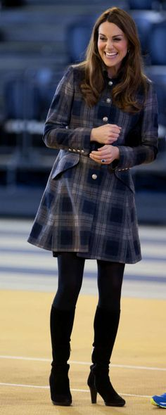 Kate wears tartan and boots early on in her pregnancy.