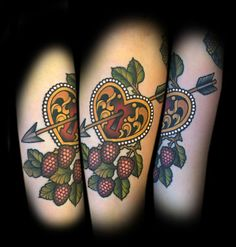 Heart under lock and arrow by tattoo artist Myra Brodsky.