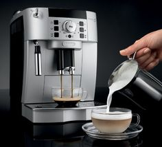 Enjoy a bold espresso, long coffee or creamy cappuccino, just the way you like it. The compact Magnifica XS boasts the advanced features of DeLonghi's super-automatic espresso machines with a smaller footprint. DeLonghi's Rapid Cappuccino System p… Cappuccino Maker, Cappuccino Machine, Espresso Maker, Espresso Coffee, Latte Machine, Breville Espresso, Coffee Coffee, Espresso Machine Reviews, Best Espresso Machine