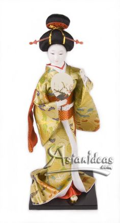 "Today's Feature Product : Japanese Geisha Doll w Gold Kimono and Fan    This 16 inches tall geisha Japanese doll, wearing a traditional kimono and carrying a hand fan, is a beautiful reminder of a long lost time!  In Japanese, the word ""gei"" translates to arts or performance, while ""sha"" means people.       http://www.asianideas.com/japanesegeishadolls2.html"