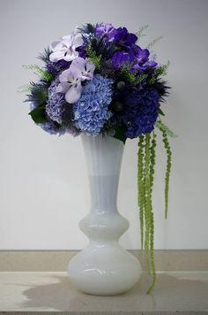 Blue bouquet in a vintage glass vase, blue Hydrangeas, lilac Orchids, purple Vanda Orchids - floral design created by Phillo Flowers