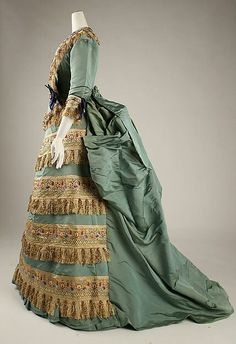 This unique 1872 Ball Gown by House of Worth has a fascinating history! Worth rarely adapted forms from the East, however, in this unusual example, he has emulated Middle Eastern enamels. The gown was worn by Mrs. William De Forest Manice at both the French and English courts during the reigns of Napoleon III and Queen Victoria. When worn on such occasions, the dress had a detachable brocade train, since destroyed. Source: MET. #VictorianStyle