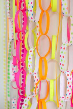 #polka-dots, #orange, #garland, #diy, #backdrop, #kids, #neon, #party-decor, #pink, #yellow, #party-idea    Read More: http://www.stylemepretty.com/living/2013/04/26/party-theme-neon-celebration/