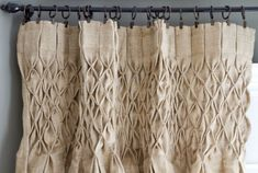 Gorgeous smocked burlap curtains.  It would take some time but these could be duplicated! :)