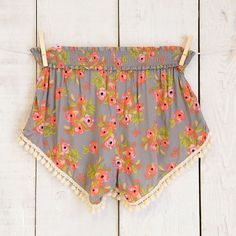 Charcoal Blooms Lounge Shorts - Loose, airy, and oh-so-soft! These Charcoal Blooms Lounge Shorts are perfect for lounging around the house or throwing over your bathing suit bottoms! Fun pompom trim adds flair and a boho feel.