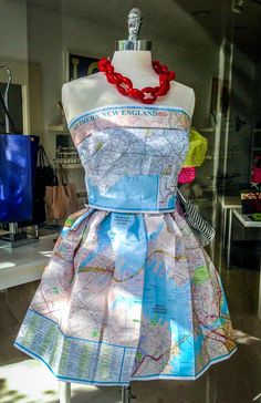 Need a window display featuring travel? Or, one that says you're away? Dress your mannequin/ dress form in maps. No mannequin? Cut dress shapes OUT of maps and tape to the window glass. Don't sell dresses? Cut some chairs and lamps out of maps!