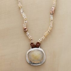 FAWN MEADOW NECKLACE�--�Jes MaHarry coaxes quiet brilliance from opal, sapphire and suede. �Love and honor� etched in sterling silver. 14kt yellow and rose gold accents