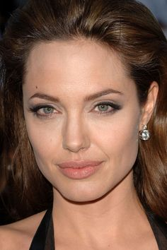 Angelina Jolie, Mr. & Mrs. Smith premiere, 2005: http://beautyeditor.ca/2014/01/24/angelina-jolie-before-and-after/