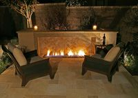 Lovely  Like the flooring and the long length of the fire Custom outdoor fireplace designs in Orange County & Los Angeles