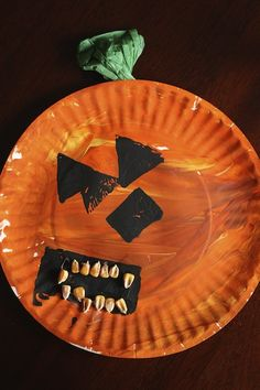3 Easy Halloween Paper Plate crafts for toddlers and preschoolers to make - crow, pumpkin and skeleton hand - Happy Hooligans