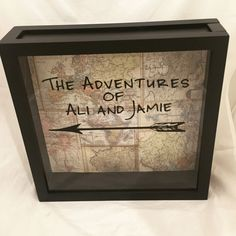 """Personalized Ticket Stub or Souvenir Holder Shadow Box 12x12 with """"Adventures of (INSERT YOUR NAMES)"""" on Vintage Map Background - Makes a Great Wedding Gift!. Do you love to travel the world and pick up souvenirs as you go? This 12x12 top loading shadow box is a great way to store your memories of all the places you've been together. There is a large sliding top that allows you to simply drop in your travel brochures, tickets, and other souvenirs to be displayed. The frame also includes..."""