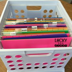 I used a basket with hanging files to organize the 35 weeks of homework! Each month has a file and the homework for that month is hanging inside ready to go! Nothin' fancy but it works!