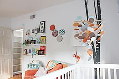 DIY Nursery Mobile using a basic circle cutter, wooden dowels, and some fishing line! #DIY #mobile