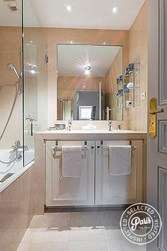 The bathroom contains a dual washbasin and sizable bathtub with shower. In a separate room you will find the WC and another washbasin.