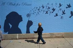 """A boy looks up at a mural reading """"A Wish for Peace"""" in Medford, Massachusetts September (Photo by Brian Snyder/Reuters) Most Popular Instagram, Like Instagram, Instagram Images, Murals Street Art, Pictures Of The Week, Album, Street Artists, Banksy, Creative Art"""