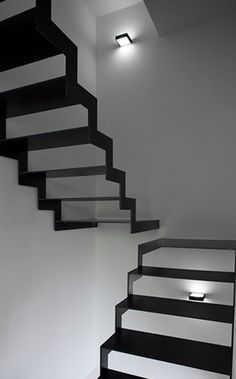 Would have been better if there was a light shining down on it to create shadows that are part of the form of the staircase. Nevertheless, an intriguing design!