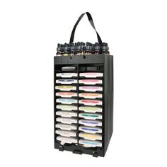 PortaInk -48 slot Ink Pad Storage rack w/ swivel and 2 panels to add to the unit to keep ink pads in place for traveling.