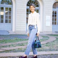 31 Perfect Looks To Copy This October #refinery29  http://www.refinery29.com/october-outfit-of-the-day-ideas#slide-14  A ruffled peasant blouse balances out loose-fitting mom jeans.Philosophy top, Levi's jeans, Tod's bag and shoes....