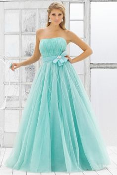 hairstyles for a strapless prom dress | long flowing hair looks nice as it cascades across the