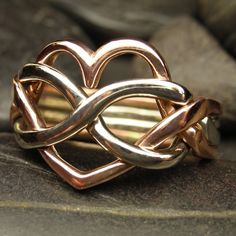 LOVE! Heart infinity puzzle ring in 10kt in rose gold and white gold - Unusual wedding ring. $445.00, via Etsy.