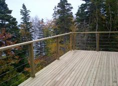 Great view from this deck. Wood post and rail with cable infill from Stainless Cable  Railing, Inc.