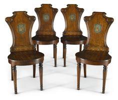 A set of four Regency mahogany hall chairs, circa 1820
