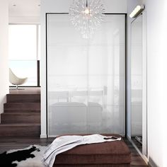 PAX white wardrobe with FÄRVIK white glass sliding doors