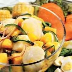 WIth only six ingredients, throw together Scallop Mango Ceviche from #EatingWell. Found at www.edamam.com.