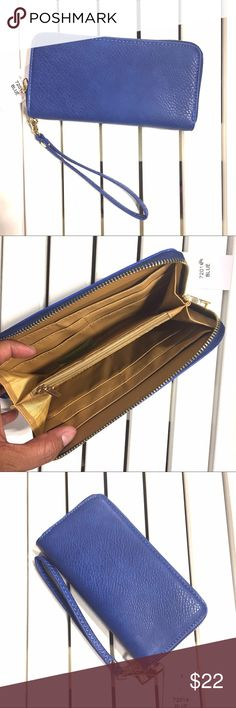 Bright blue clutch Be chic in blue with this simple wallet. Includes strap to be wristlet. Faux leather. 7.25x3.75x1 Bags