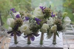 Blue and white buttonholes British flowers