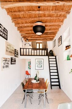 In Ibiza, Spain, Standard Studio transformed a 200-year-old stable and storehouse into a guest home and showroom full of conversation starters—think original aromatic cedar ceiling beams and ancient stone walls | archdigest.com