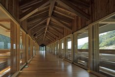 Yusuhara Wooden Bridge Museumby Kengo Kuma and Associates This bridge and museum is supported by 180 mm by 300 mm (7 inches by 11.8 inches) laminated timbers. The interlocking horizontals are supported by a single column in the middle and become progressively longer across the 47 meter (154 feet) span.