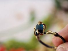 """Check out my new line """"Wild Thing"""" : Women's #Gemstone Rings, Ear Rings and Earring Dangles Gorgeous #blue green #indicolite #tourmaline raw crystal is wrapped with 14K solid #gold prongs. The stone is about 9 mm by 5 mm.  #Ring band is oxidized sterling silver fused w... #rough #facet #jewelry #gemstone #variance #ring #wedding #engagement #ring #stacking #stack #natural"""