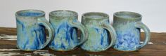 Set of handmade ceramic blue mugs by Theresa Ruzek Pottery.