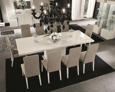 Elegant contemporary dining table that will offer a touch of class and sophistication to any dining area. Available in a white high gloss finish with white carrara marble on the base of the table. This superbly designed table is as beautiful as it is functional and the timeless design ensures that it will be as effective in a contemporary or traditional setting.