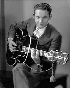 Les Paul (1915-2009) American; jazz, country, and blues guitarist, songwriter, inventor and one of the pioneers of the solid-body electric guitar