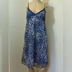 Rebecca Taylor Blue Animal Print Dress Rebecca Taylor Blue Animal Print Dress. Adjustable spaghetti straps. Elastic under bust. 100% Cotton Lining. Chiffon overlay is 100% Polyester. Machine Wash. Small black mark on lining inside bust, but not visible when wearing as its under the navy stripe otherwise EUC.   No Trade or PP  Offers Considered  Bundle discounts Rebecca Taylor Dresses