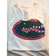 Florida Nike Tank also has a blue nike sign at the bottom of the shirt•pretty firm on price but offers are welcome•no trades•I do bundle• Nike Tops Tank Tops
