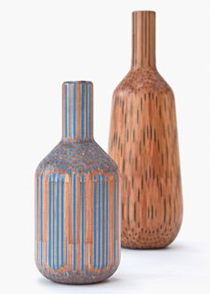 Amalgamated vases by Tuomas Markunpoika (Pencils glued together and milled to produce vessels strakes with the coloured leads)