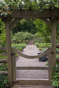 Raised Bed Vegetable & Herbs Garden Fenced Gate, stone pebble walkway, protection from pest animals, fruit trees at rear by sheila.moose