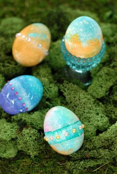 Stained Glass {Bleeding Tissue} Easter Eggs ~T~ all you need is colored tissue paper,and a spray bottle or sponge. You can embellish with stick on jewels. Fun and easy for the little ones.