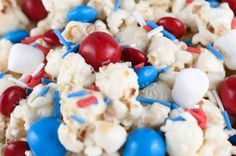Adding candy to the Patriotic Popcorn