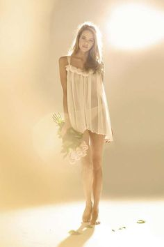 Ethereal Wedding Lingerie. Beautiful idea to accesorize with a matching bouquet heading to the honeymoon bed. Nice way to hide his wedding present.