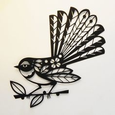 This New Zealand Piwakawaka bird has been cut out of firm black paper using my amazing cuttting machine. (I design it it, cuts it for me!) I have included removable adhesive so you can very easily decorate your wall. I love the way a subtle shadow is created. I have sold these to customers who frame them too! The fantail is about A4/ 8 x 10 inches in size, it looks great with the Tui papercut too