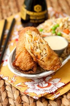 Pork Egg Rolls: 1 lb. ground pork 3/4 head cabbage, shredded thin 3 carrots, peeled and shredded 2 1/2 cups fresh bean sprouts (about 2 packages) 3 cloves garlic, minced 3 Tbsp soy sauce 4 scallions (green and white), sliced 2 Tbsp vegetable oil 1 package egg roll wrappers 1 tbsp cornstarch, mixed with 3 tbsp cold water (for sealing wrappers) Vegetable oil, for frying