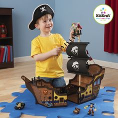 @Overstock.com - KidKraft Pirate Ship Play Set - Shiver me timbers, with its fun, interactive design and detailed accessory pieces, this wooden play set from Kid Kraft is a perfect gift for any young swashbuckler. Features include two molded pirates, treasure chest and a cannon.  http://www.overstock.com/Sports-Toys/KidKraft-Pirate-Ship-Play-Set/7179411/product.html?CID=214117 $58.99