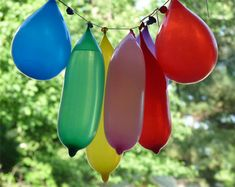 Water balloon pinata! What fun in the hot summer!  So have to remember this! this would be fun at the camp ground