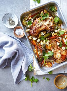 This easy pork chop recipe is served with roasted courgette and tangy feta – it's the perfect midweek meal.